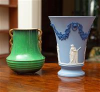 Sale 8735 - Lot 46 - A Carltonware verte royale deco vase together with a Wedgwood blue jasper beaker form vase depicting ladies, Height of Wedgwood 15cm