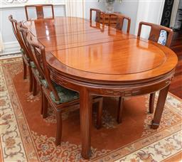 Sale 9256H - Lot 54 - A Chinese rosewood extension dining table of oval form with carved frieze, H 76cm x L fully extended 250cm (each leaf 40.5cm of whic...