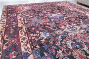 Sale 8489A - Lot 24 - A large woollen tone geometric and floral design Persian carpet in jewel tones, 305 x 210cm