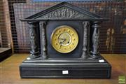 Sale 8520 - Lot 1012 - Victorian Black Slate Mantle Clock of Temple Form with a Gilt Brass Recessed Dial and Figural Brass Mounts. (Top Loose)