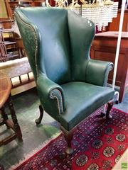 Sale 8559 - Lot 1091 - Georgian Style Green Leather Wingback Armchair, with brass studs & cabriole legs