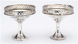Sale 9085S - Lot 10 - Pair of  George V Sterling Silver raised and pierced tazzas, hallmarked Brimingham 1920, maker L & S, weighted, height 10, diameter...