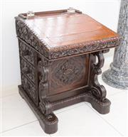 Sale 8338A - Lot 74 - A Victorian carved oak davenport, with hinged top and three drawers, H 78 x W 62 x D 58cm