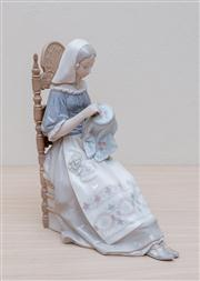 Sale 8430 - Lot 37 - A Lladró lady in costume doing needlework