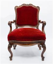 Sale 8660A - Lot 48 - An antique French walnut bergere C: 1880. The scroll carved and shaped back with outswept shaped and knurled arms. The frame back an...