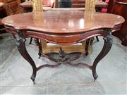 Sale 8868 - Lot 1125 - 19th Century Dutch Rosewood Centre Table, the serpentine top fitted with two frieze drawers, raised on cabriole legs joined by a str..