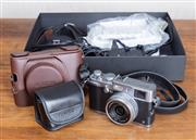 Sale 8694A - Lot 64 - A Fuji film X100S with accessories