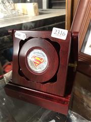 Sale 8819 - Lot 2316 - Silverplate Superman Themed Token