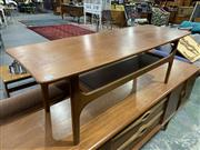 Sale 9002 - Lot 1087 - Remploy Teak 1960s Coffee table with magazine Shelf (h:40 x w:116 x d:40cm)