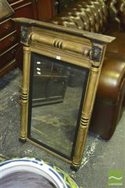 Sale 8345 - Lot 1057 - Regency Gilt & Ebonised Mirror, flanked by turned leaf capped pilasters