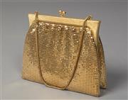Sale 8493A - Lot 70 - A vintage Oroton gold glomesh purse with orange silk lining in good condition, 18cm wide