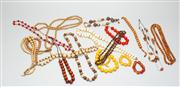 Sale 8740F - Lot 82 - An assortment of beaded jewellery of predominantly earth toned necklaces with examples in yellow and burnt orange, longest 75cm