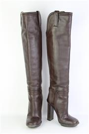Sale 8782A - Lot 170 - A pair of Gucci knee high brown leather boots with blocked heel and pipe detailing, Made in Italy, size 37 with original box and dus...