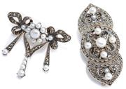 Sale 8954 - Lot 367 - TWO SILVER CULTURED PEARL AND MARCASITE BROOCHES; a bow brooch with 3 fringe drops and a two way double clip brooch, widths 4cm and...
