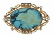 Sale 8442J - Lot 398 - A TURQUOISE AND PEARL BROOCH; 9ct gold vintage oval frame set with seed pearls, centring a later polished turquoise plaque, 52 x 35m...