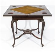 Sale 8660A - Lot 31 - An antique English ebonised finish on mahogany swivel envelope top card table C: 1910. The 4 section top opening on a swivel to reve...