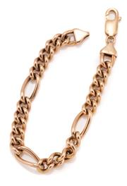 Sale 9095 - Lot 310 - A 10CT GOLD FIGARO LINK BRACELET; with parrot clasp, width 7.5mm, length 18cm, wt. 10.37g.