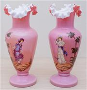 Sale 8430 - Lot 38 - A pair of Edwardian pink glass mantel vases decorated with ladies of fashion. Height 38cm.