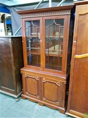 Sale 8601 - Lot 1142 - Antique Style Carved Mahogany Bookcase (in one piece)