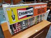 Sale 8765 - Lot 1060 - Vintage Champion Spark Plug Rack with Plugs