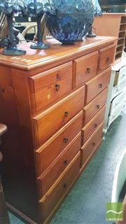 Sale 8390 - Lot 1553 - Timber Chest of Eleven Drawers