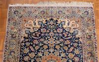 Sale 8735 - Lot 56 - A Cadrys Persian fine woollen Nain carpet with central medallion, floral arabesques on a blue ground with green border, 148cm x 105...