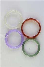 Sale 8815C - Lot 41 - Set Of Four Bangles Including Purple, Brown, Clear And Green