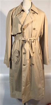 Sale 9080F - Lot 67 - AN YVES SAINT LAURENT DOUBLE BREASTED TRENCHCOAT; with two button up side pockets, one internal zip up pocket and a belt, Size 40/50...