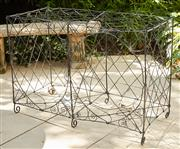 Sale 9081H - Lot 2 - An antique French wire pot stand, height 79cm x Width 110cm x Depth 50cm