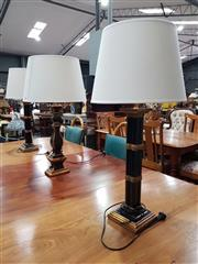Sale 8676 - Lot 1027 - Pair of Black and Gold Table Lamps Together with Similar Example