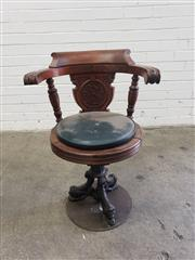 Sale 9085 - Lot 1067 - Late Victorian Carved Walnut Captains Chair, with cast iron base ending in lions & mounted on later base, with unidentified carved...
