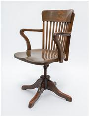 Sale 8660A - Lot 23 - An antique Australian Federation Queensland maple captains desk chair C: 1910. The collared back with 9 staves to the highly figured...