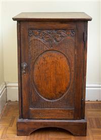 Sale 8735 - Lot 58 - A turn of the century oak pot cupboard with art nouveau decoration, H x 72cm, W x 44, W x 42cm