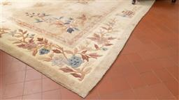 Sale 9256H - Lot 62 - A large Chinese wool carpet with floral design on cream ground, 310cm x 244cm, some wear.