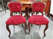 Sale 8868 - Lot 1109 - Interesting Set of Four Victorian Carved Walnut Chairs, with buttoned back and seat upholstered in red cut-moquette velvet