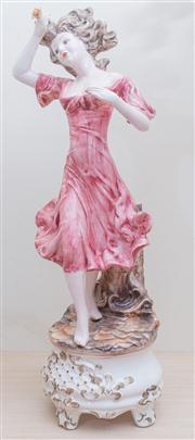Sale 8430 - Lot 33 - A Capodimonte figure of a lady