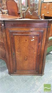 Sale 8375 - Lot 1068 - George III Oak Hanging Corner Cupboard, with shell cameo inlay and serperntine fronted shelves