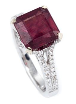 Sale 9246J - Lot 385 - AN 18CT WHITE GOLD RUBY AND DIAMOND RING; 4 claw set with a step cut treated ruby to gallery and split shoulders set with a total of...