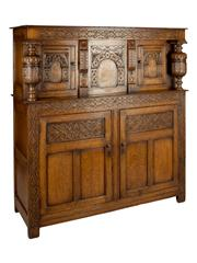 Sale 8379A - Lot 74 - Antique English Elizabethan Style Oak Court Cabinet Profusely carved throughout, the top with two cabinet doors above two panelled...