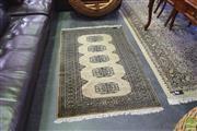 Sale 8390 - Lot 1307 - Green Tone Floor Rug (150 x 97)