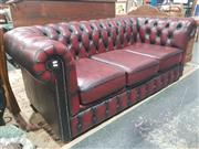 Sale 8760 - Lot 1019 - Burgundy Leather Three Seater Chesterfield Sofa
