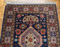 Sale 8735 - Lot 65 - A Persian woollen runner in geometric pattern on blue ground 303 x 83cm