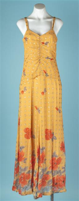 Sale 9092F - Lot 91 - A VINTAGE MUSTARD & GOLD EVENING GOWN; with floral design and zip to back. Size S (Small stain)