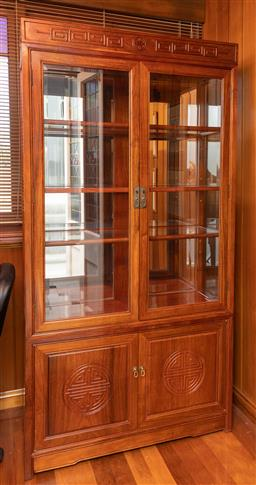 Sale 9256H - Lot 58 - A rosewood and bevelled glass fronted display cabinet with two doors above two panelled doors, shelved throughout with mirrored back...