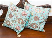 Sale 8338A - Lot 89 - A pair of turquoise Turkish cushions with tassles, 50 x 50cm