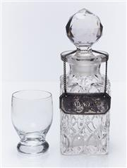 Sale 9080W - Lot 45 - A miniature cut crystal decanter and stopper with a silver plated brandy bottle ticket Height 15cm together with a small glass,.