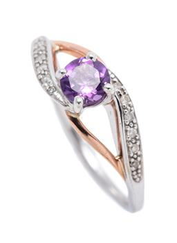 Sale 9246J - Lot 345 - A 9CT GOLD AND SILVER STONE SET RING; centring a round cut amethyst to split shoulders in gold and silver set with 12 single cut dia...
