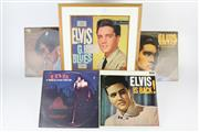 Sale 8403 - Lot 80 - Elvis The King Presley Picture in Frame with Associated Records