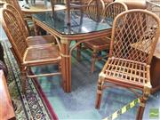 Sale 8495F - Lot 1036 - Cane Seven Piece Setting incl. Smokey Glass Top Table & Six Cane Dining Chairs