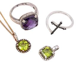 Sale 9145 - Lot 328 - TWO SILVER GEMSET PENDANTS AND RINGS; pendants set in silver and silver gilt with an emerald cut and round cut peridot and diamond s...
